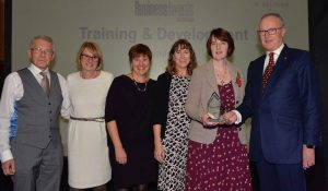 Ann and the team receiving the Eastbourne Business Award 2018 for Training and Development